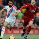 Jordan Henderson of Liverpool and Andros Townsend of Crystal Palace