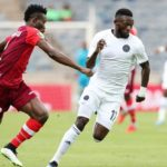 Augustine Mulenga of Orlando Pirates challenged by Hudu Yakubu of Horoya