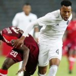 Bolaji Sakin of Horoya challenged by Happy Jele of Orlando Pirates