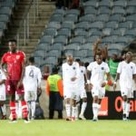 Justin Shonga of Orlando Pirates celebrates his goal with his teammates