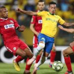 Achraf Dari and Brahim Nakach of Wydad challenges Gaston Sirino of Mamelodi Sundowns