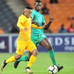 Hendrick Ekstein of Kaizer Chiefs challenged by Antony Agay Akumu of Zesco