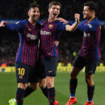 Philippe Coutinho of Barcelona celebrates scoring alongside Sergi Roberto and Lionel Messi