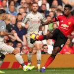 Liverpool top after Man Utd stalemate