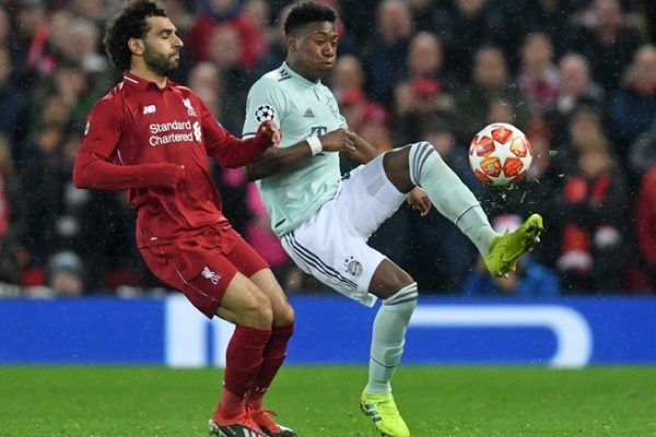 Mohamed Salah of Liverpool challenges David Alaba of Bayern Munich