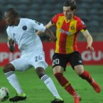 Ayman Ben Mohamed of Esperance challenged by Asavela Mbekile of Orlando Pirates