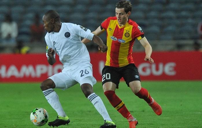 Ayman Ben Mohamed of Esperance challenged by Asavela Mbekile of Orlando Pirates