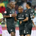 Luvuyo Memela of Orlando Pirates celebrates with Musa Nyatama and Vincent Pule