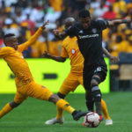 Hendrick Ekstein challenges Vincent Pule for the ball