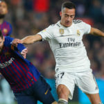 Lucas Vazquez of Real Madrid and Lionel Messi of Barcelona