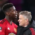 Manchester United's Paul Pogba and caretaker manager Ole Gunnar Solskjaer
