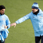 Manchester City manager Pep Guardiola and assistant Mikel Arteta