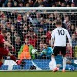 Milner sends Liverpool top