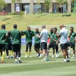 Stuart Baxter, coach of Bafana Bafana chats with players during a training session
