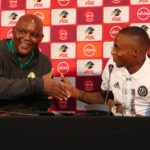 Pitso Mosimane, coach of Mamelodi Sundowns with Thembinkosi Lorch of Orlando Pirates