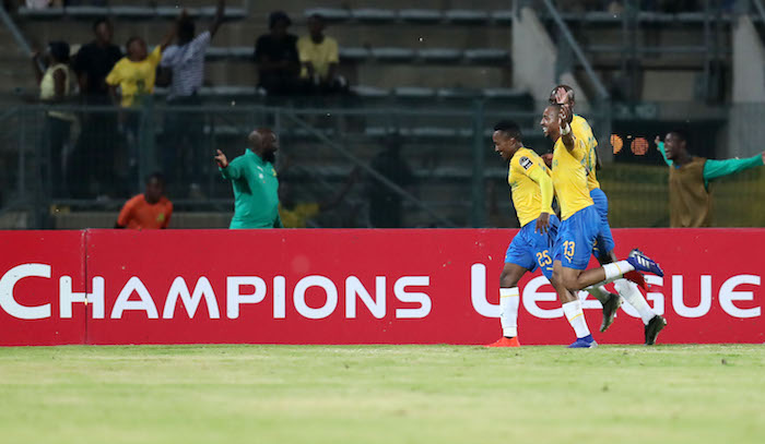 Lebohang Maboe celebrates his goal with Tiyani Mabunda and Anthony Laffor
