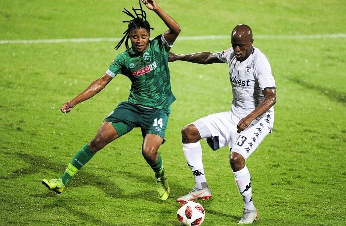 Siyethemba Sithebe of AmaZulu FC and Sifiso Hlanti of Bidvest Wits