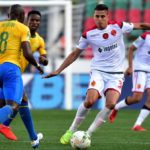 Achraf Dari of Wydad Athletic Club challenged by Hlompho Kekana of Mamelodi Sundowns