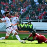 Salaheddine Saidi of Wydad Athletic Club challenged by Denis Onyango of Mamelodi Sundowns