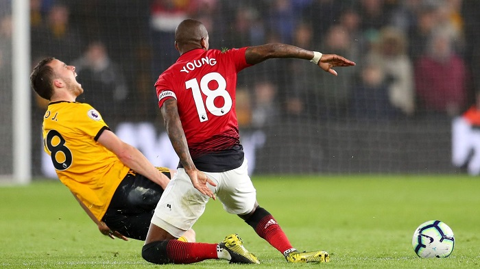 Ashley Young of Manchester United sent off for his challenge on Diogo Jota of Wolves