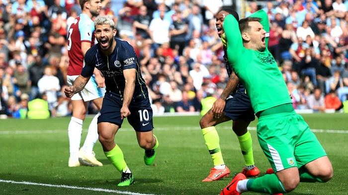 Sergio Aguero of Manchester City wheels away to celebrate after his opening strike