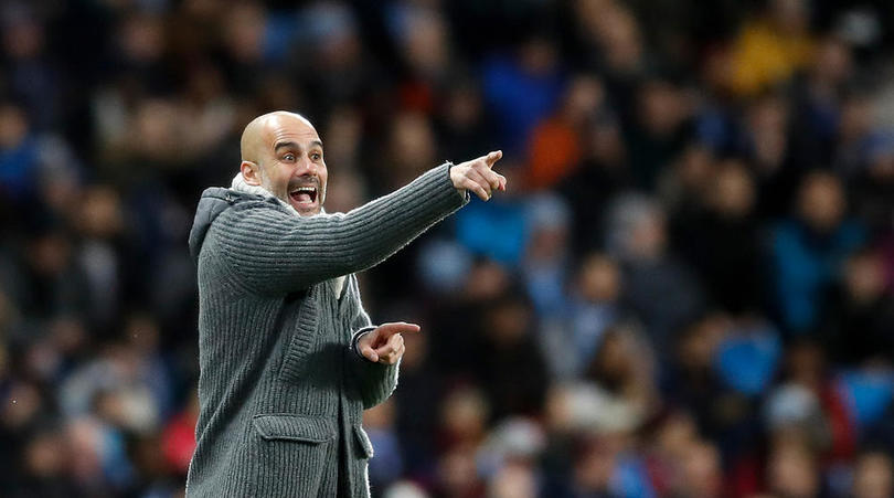 Manchester City manager Pep Guardiola on the touchline