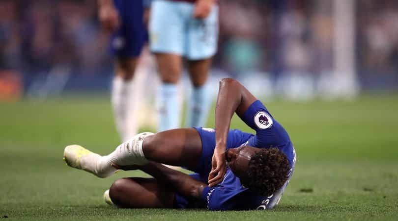 Chelsea's Callum Hudson-Odoi picks up an injury during the Premier League match at Stamford Bridge