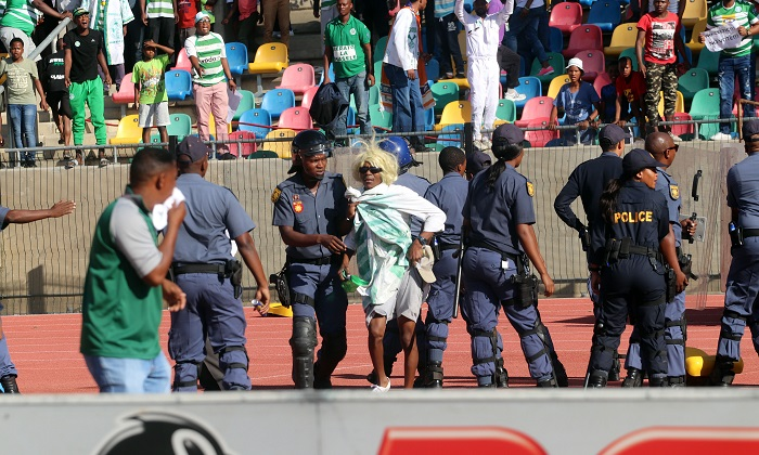 Police escorting Bloemfontein Celtic supporters off the field