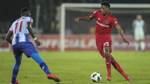 Vincent Pule of Orlando Pirates takes on Fortune Makaringe of Maritzburg United