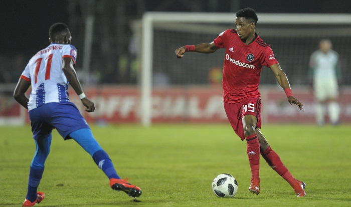Vincent Pule of Orlando Pirates takes on Fortune Makaringe of Maritzburg United