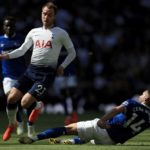 Spurs' Christian Eriksen evades a challenge from Cenk Tosun of Everton