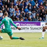 United's top-four hopes ended by Huddersfield