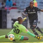 Thembinkosi Lorch of Orlando Pirates scores a goal against Lehlohonolo Phali of Polokwane City