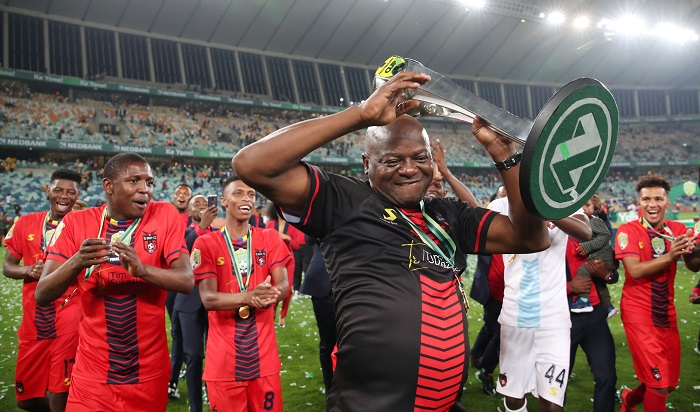 Daniel Malesela, coach of TS Galaxy celebrates with the Nedbank Cup trophy