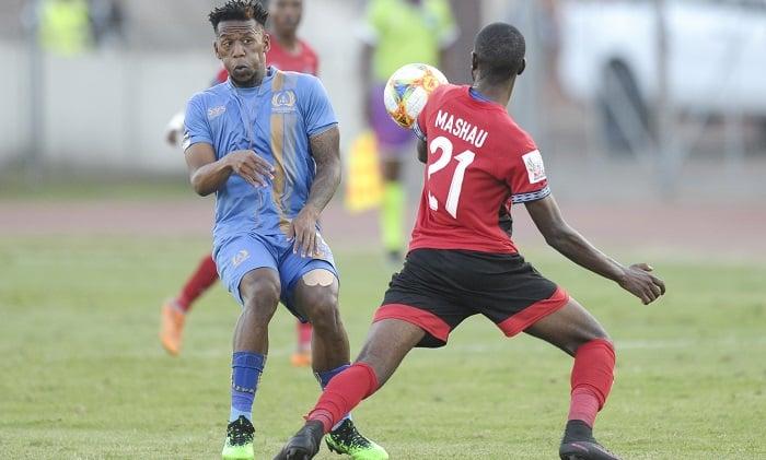 Happy Mashau of Tshakhuma Tsha Madzihandila FC challenged by Diego Brown of Royal Eagles FC