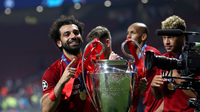 Liverpool's Mohamed Salah celebrates with the trophy after the UEFA Champions League Final at the Wanda Metropolitano, Madrid.
