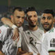 Algerian players celebrate after their opening Afcon victory
