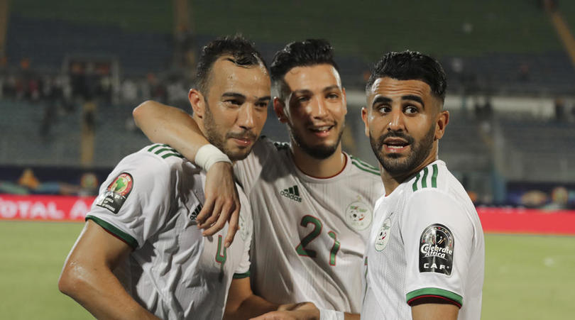 Algerian players celebrate after securing their Afcon progression