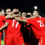The Moroccan players celebrate