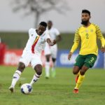 Juma Balinya of Uganda challenged by Keanu Cupido of Bafana Bafana