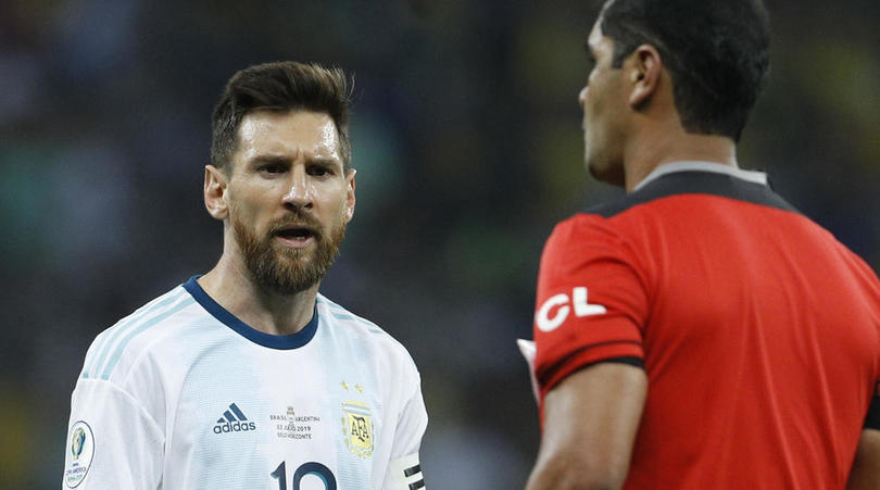 Argentina's Lionel Messi, left, complains to to the referee