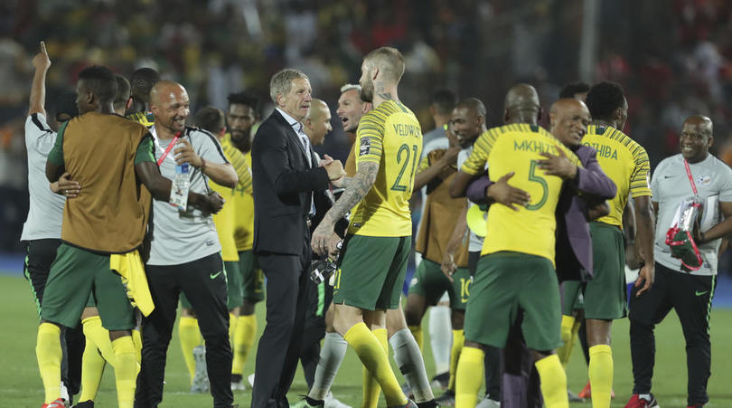 Bafana Bafana head coach Stuart Baxter celebrates with his player after beating Egypt