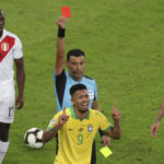 Referee Roberto Tobar shows the red card to Gabriel Jesus of Brazil