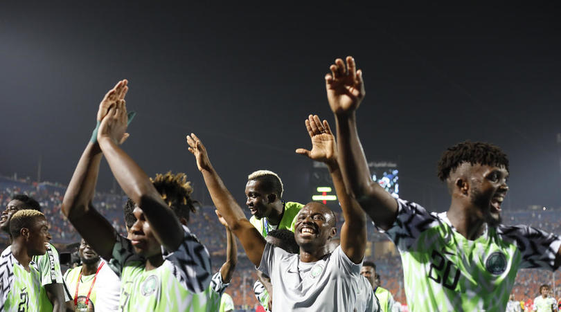 Nigerian players celebrate after to progressing to the Afcon semis