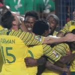 Bafana Bafana players celebrate after Thembinkhosi Lorch netted the winner against Egypt