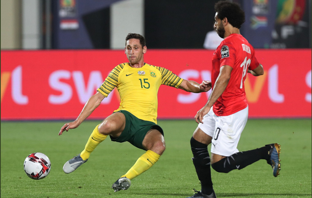 Dean Furman of Bafana Bafana challenges Mohamed Salah of Egypt
