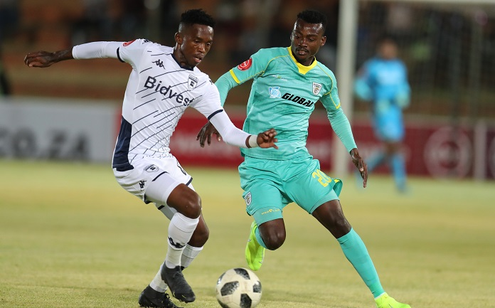Thabang Monare of Bidvest Wits challenged by Tshediso Patjie of Baroka FC