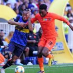 Wiseman Maluleke of Polokwane City challenged by Edmilson Dove of Cape Town City