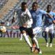 Happy Jele of Orlando Pirates challenged by Lerato Manzini of Chippa United