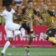 Kearyn Baccus of Kaizer Chiefs challenged by Puleng Tlolane of Polokwane City
